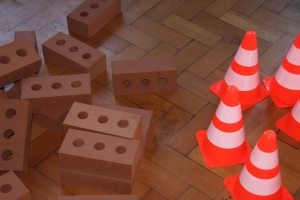 Bricks, cones, hard hats, building